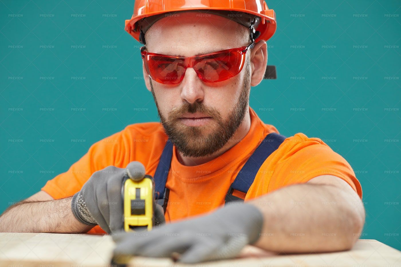 Carpenter Measuring Wooden Detail...: Stock Photos
