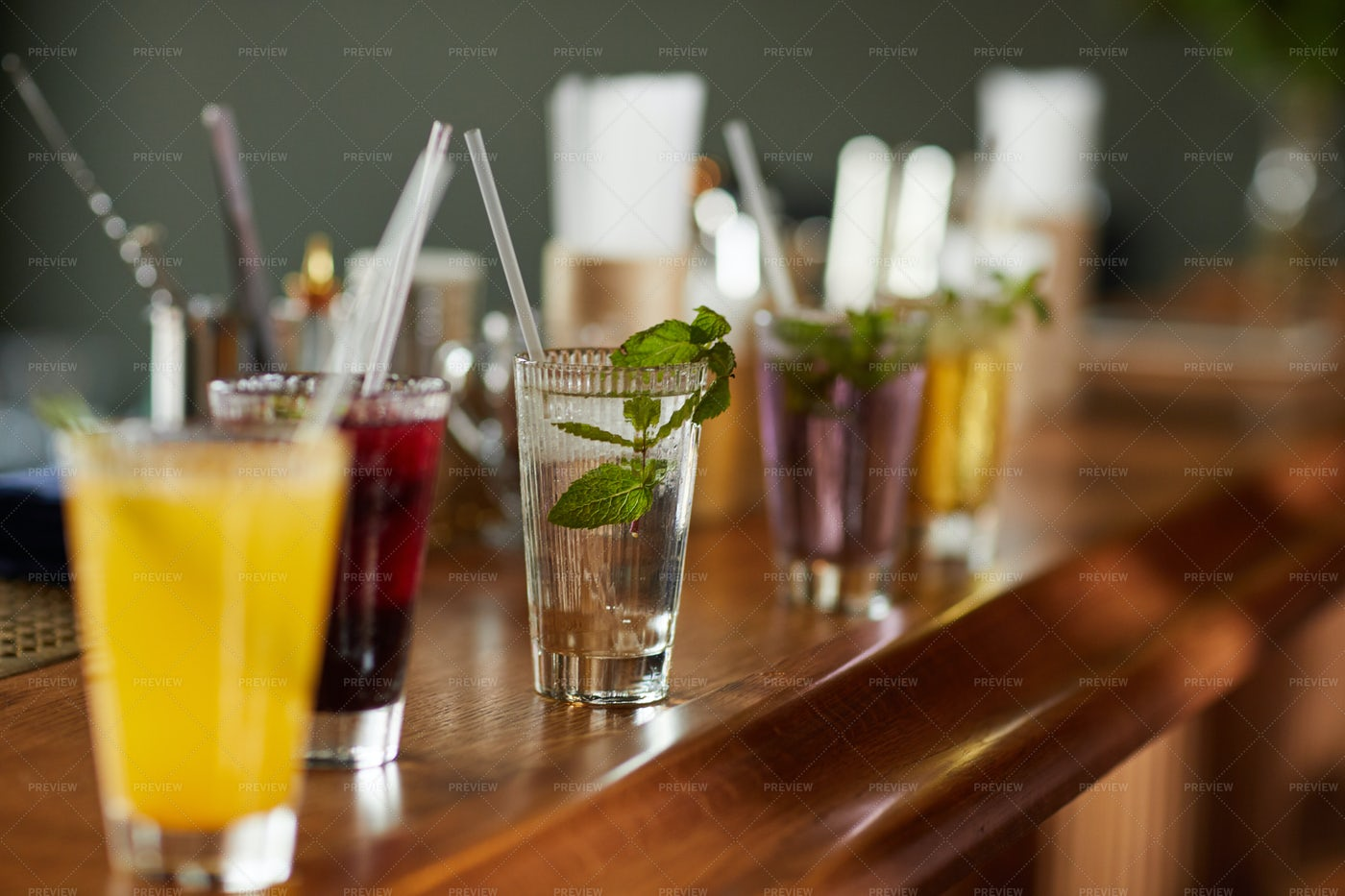 Colorful Cocktails On Bar Counter: Stock Photos
