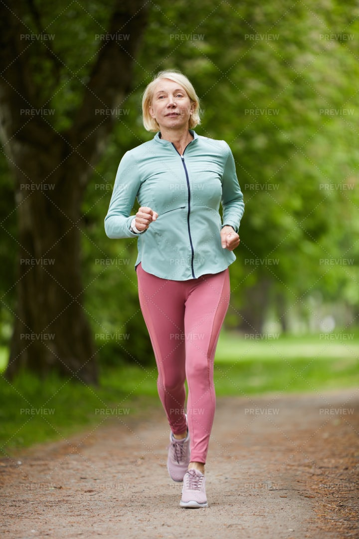 Sportswoman In Park: Stock Photos