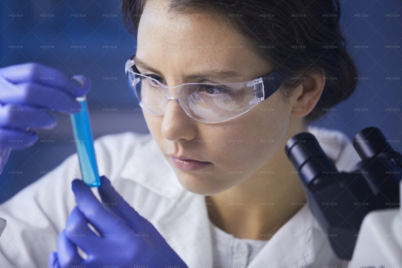 Female Scientist Studying Test...: Stock Photos
