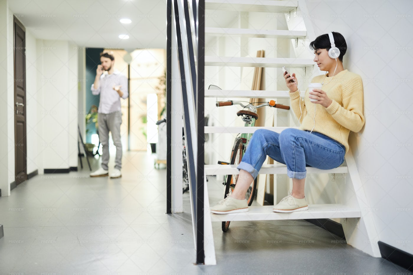 Hipster Girl In Headphones Choosing...: Stock Photos