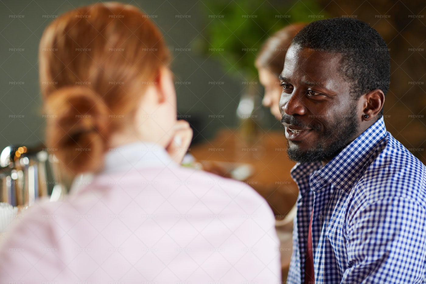 African Man Talking To Woman In...: Stock Photos
