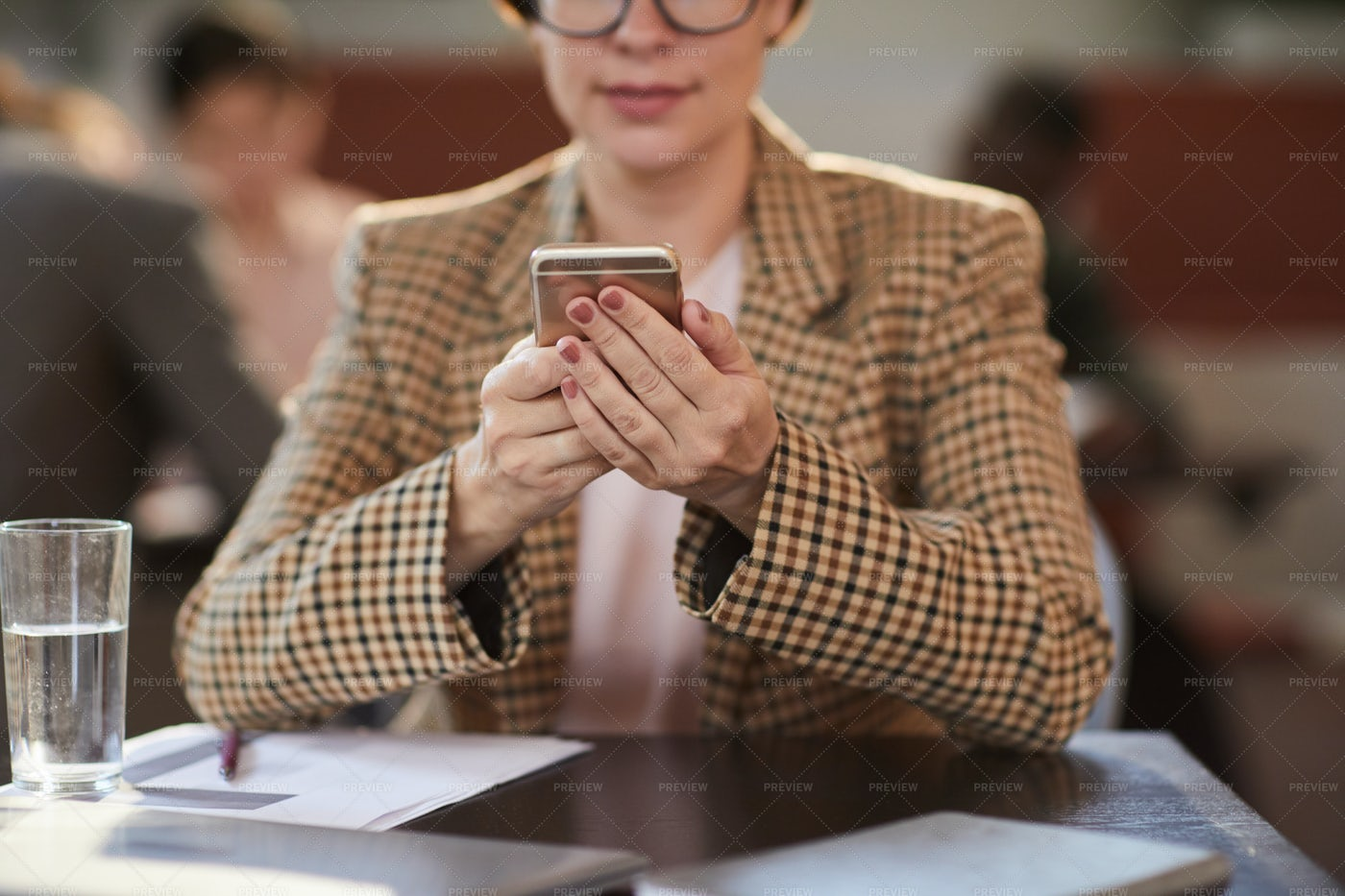 Woman Using Smartphone In Cafe: Stock Photos