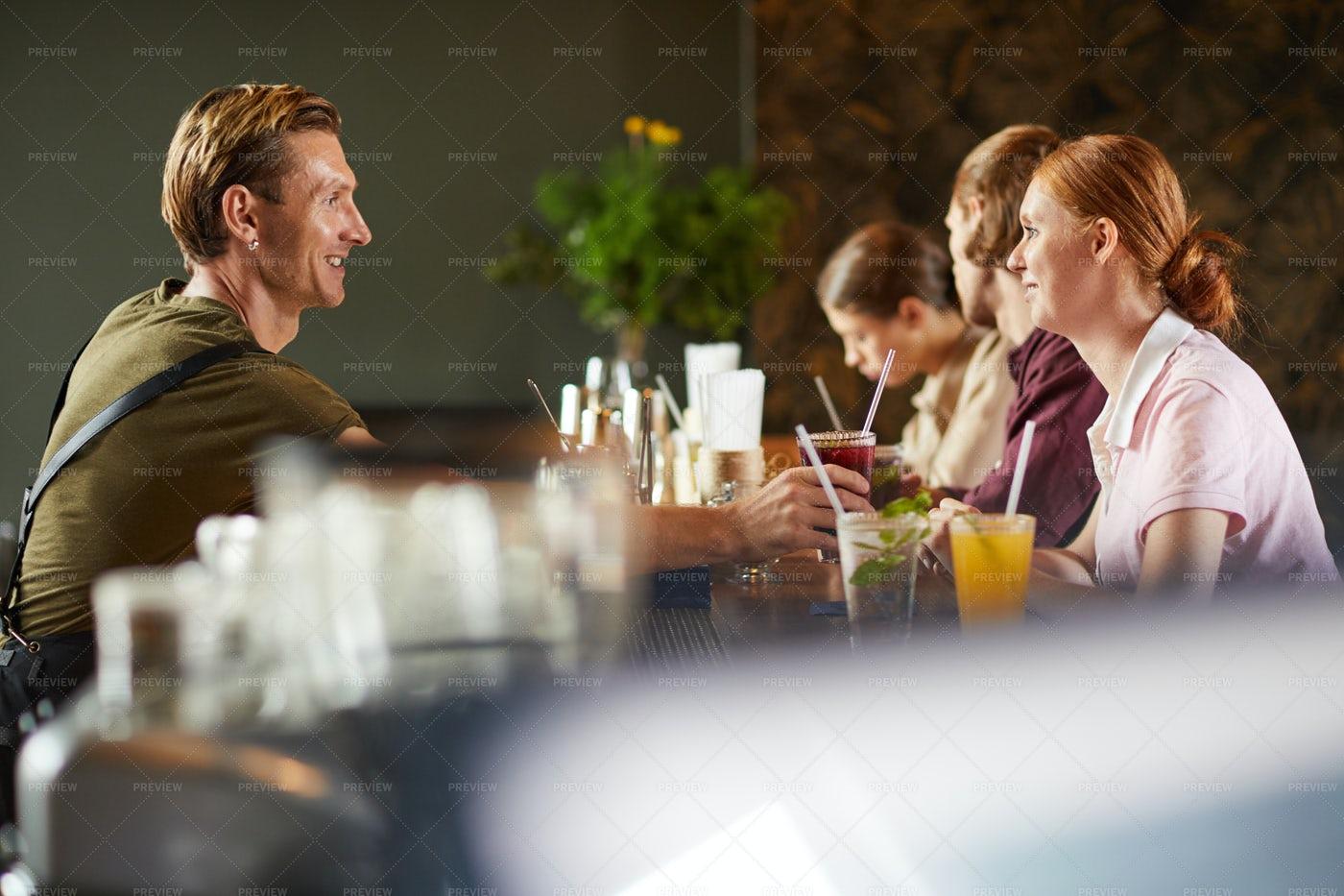 Young Couple Enjoying Date In Bar: Stock Photos