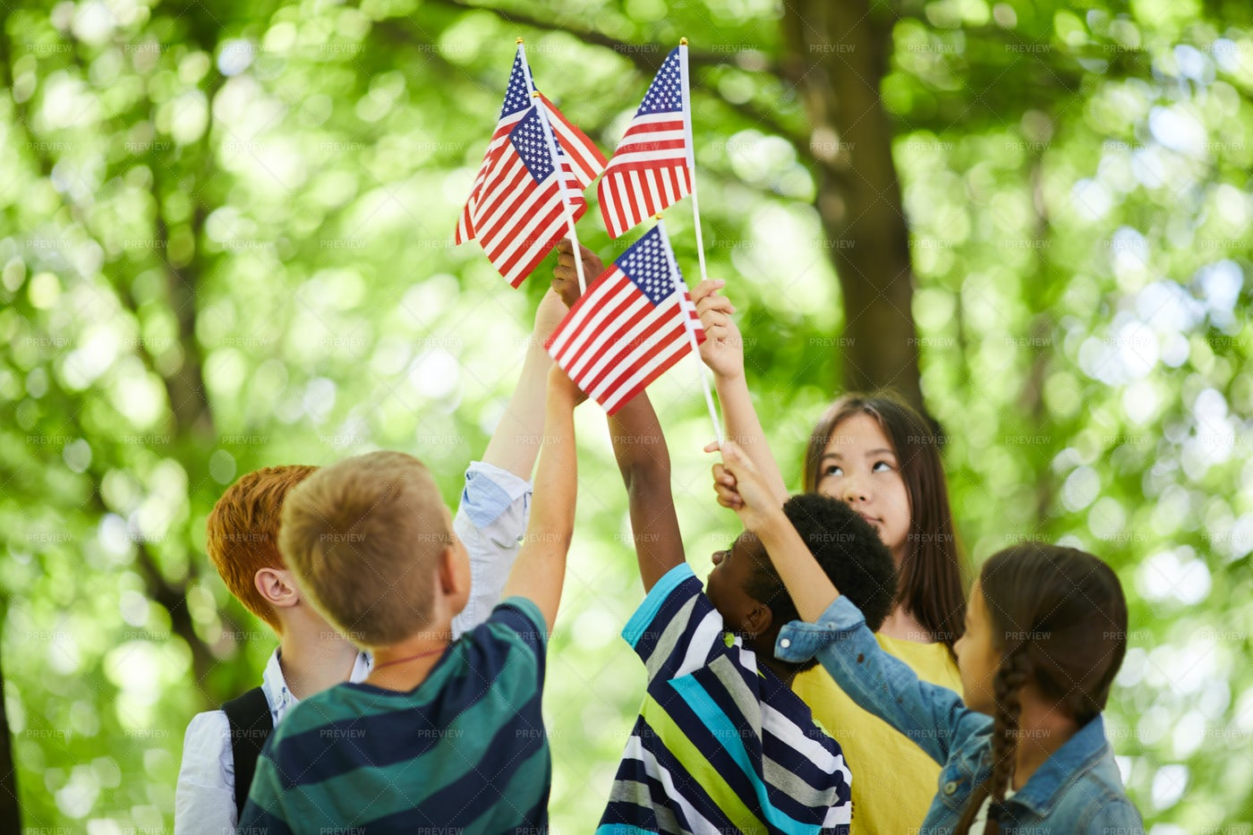 Children Raising Us Stick Flags...: Stock Photos