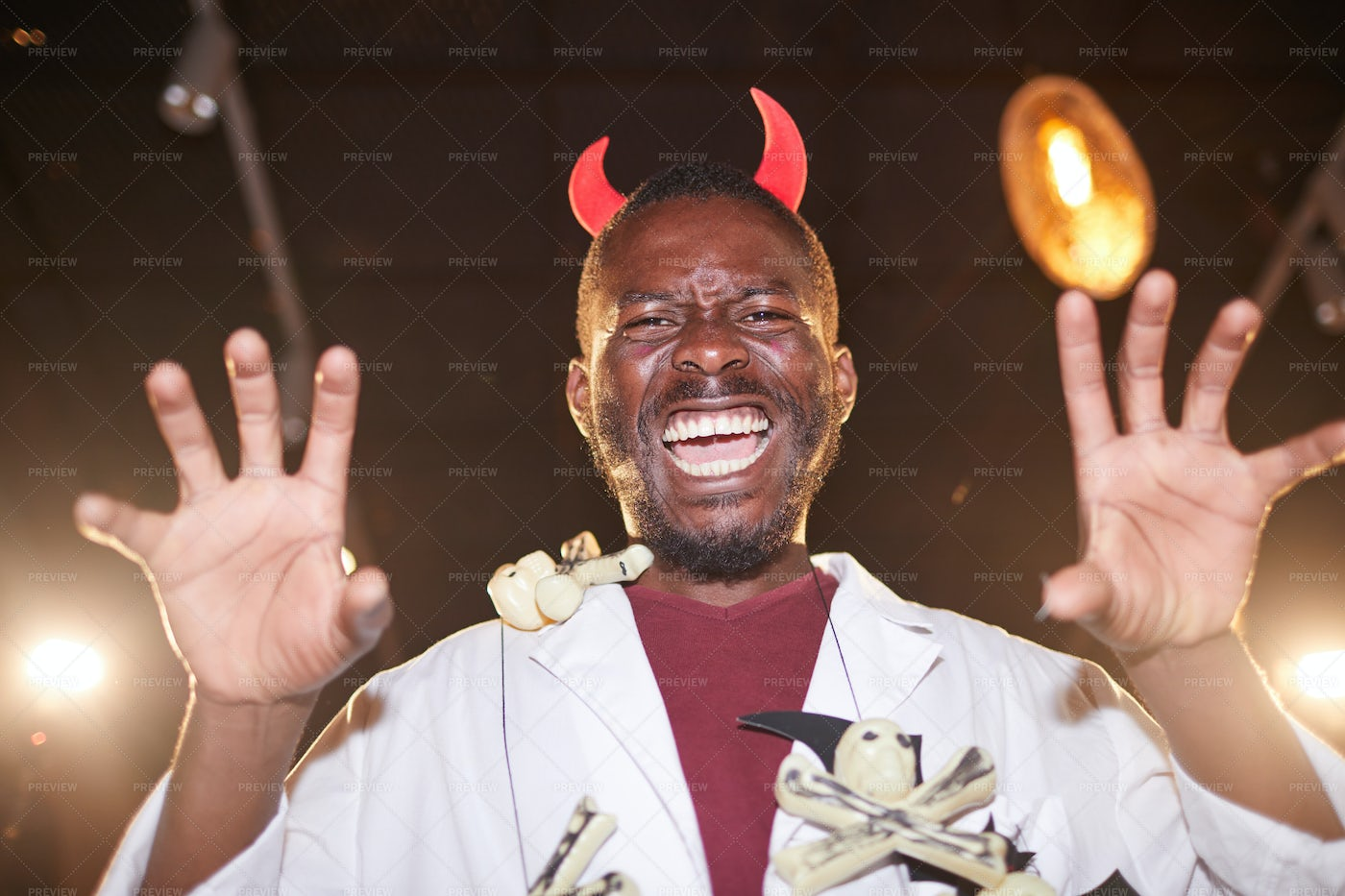 African Man In Devil Costume On...: Stock Photos