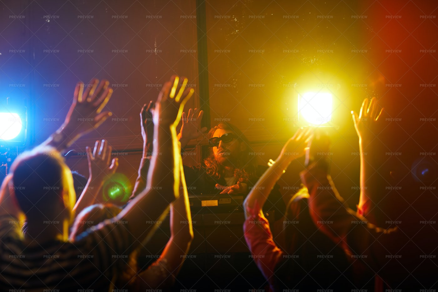 Young DJ Waving Hands Together With...: Stock Photos