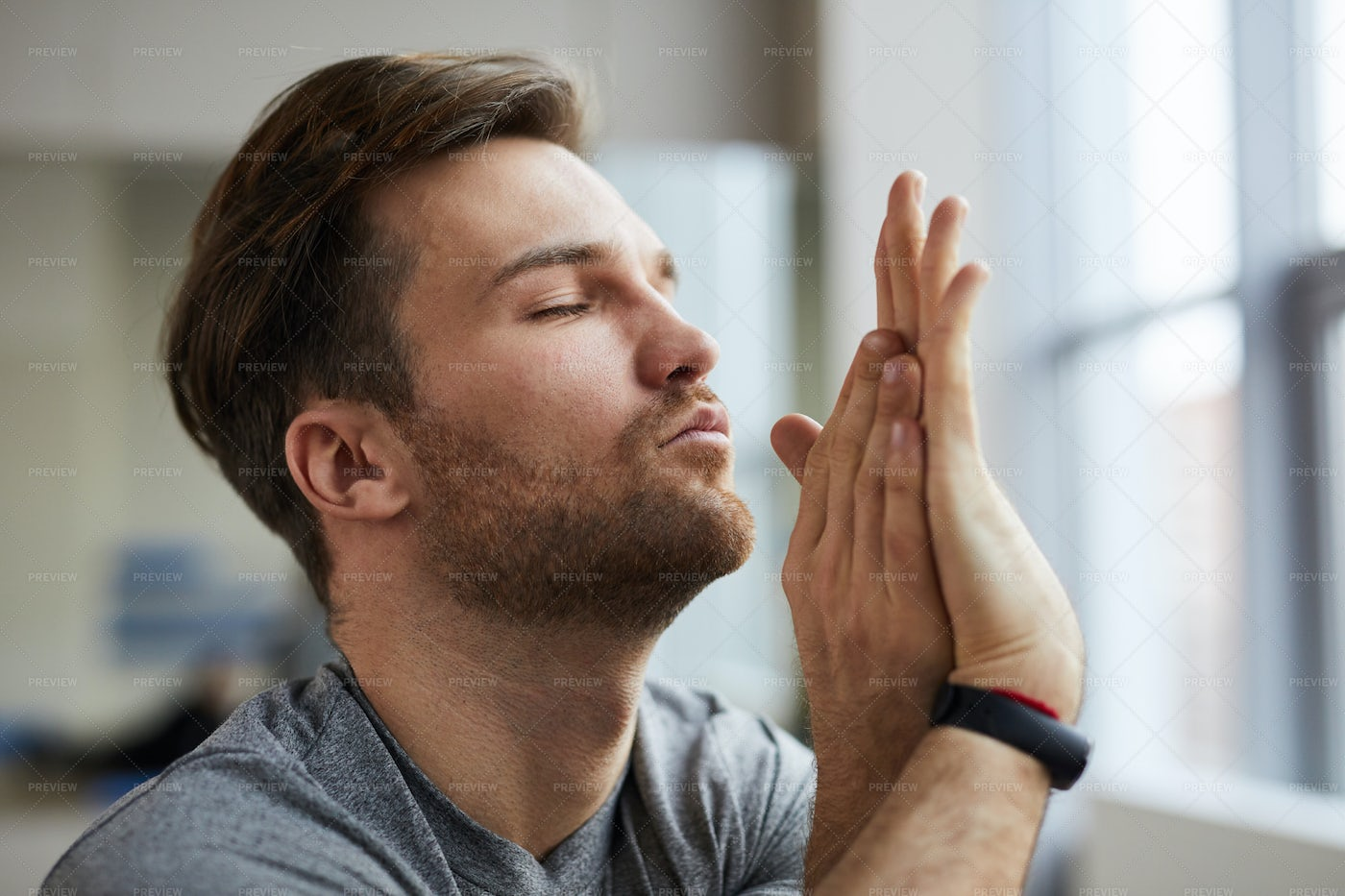 Concentrated Man With Twisted Arms: Stock Photos