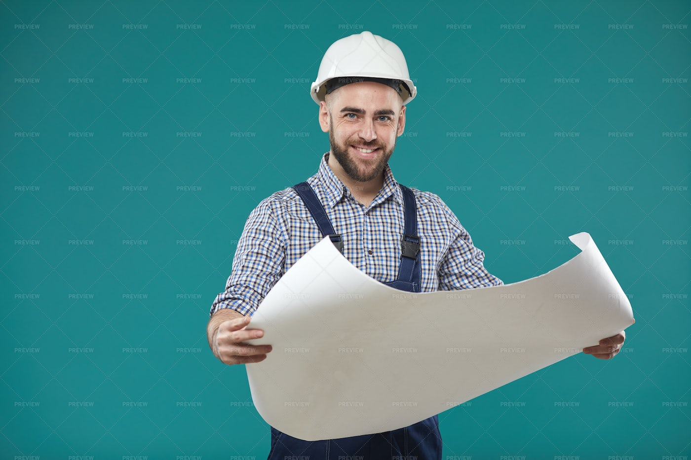 Engineer With Building Plan...: Stock Photos