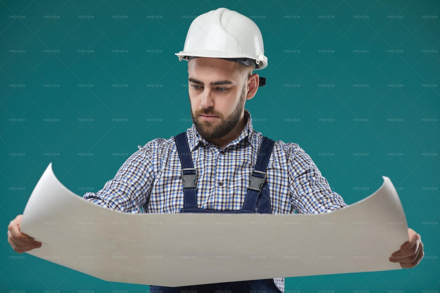 Foreman Looking At Building Plan: Stock Photos