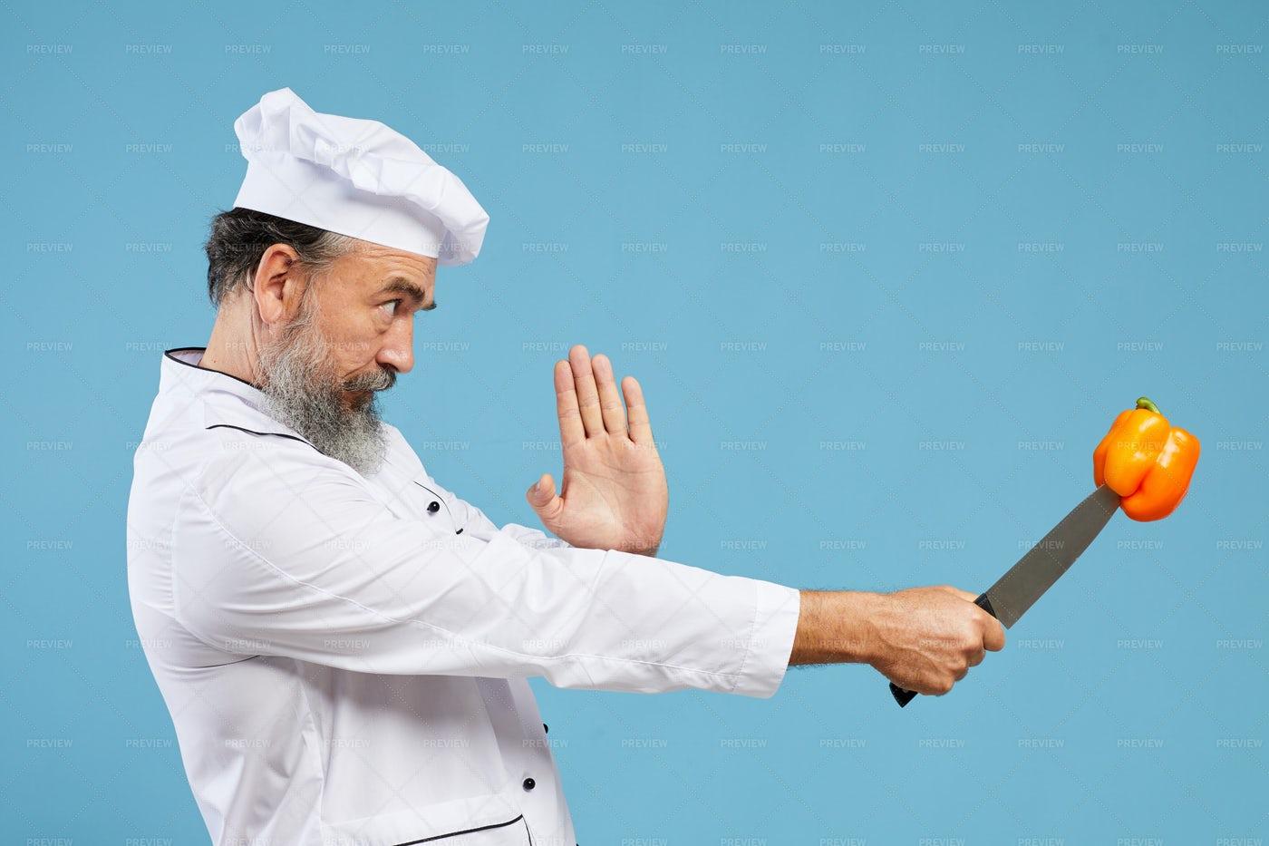 Senior Chef En Garde: Stock Photos