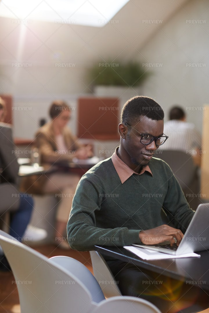 Young African-American Man Working...: Stock Photos
