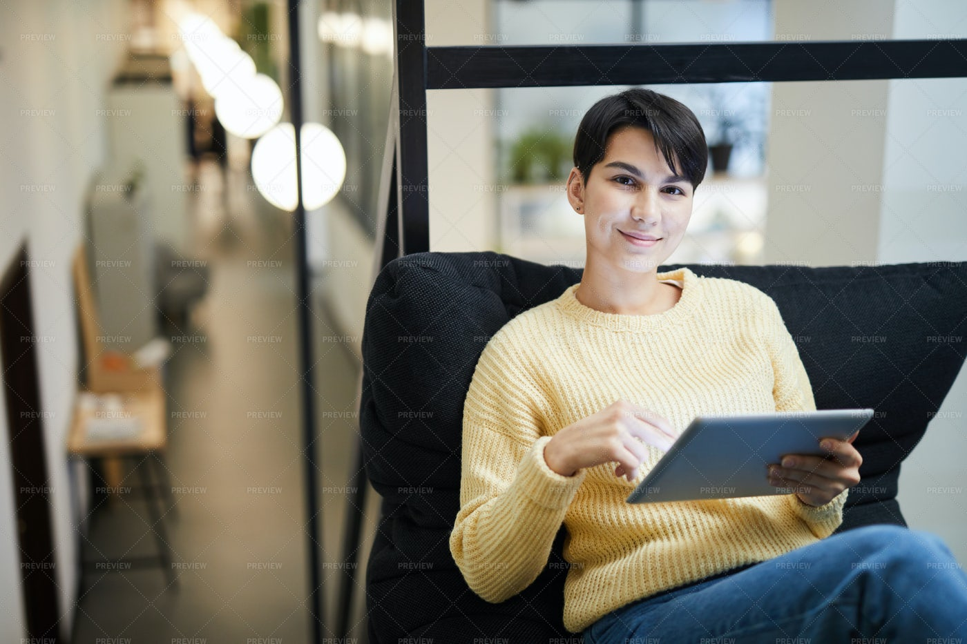 Pretty Lady Using Tablet In Cozy...: Stock Photos