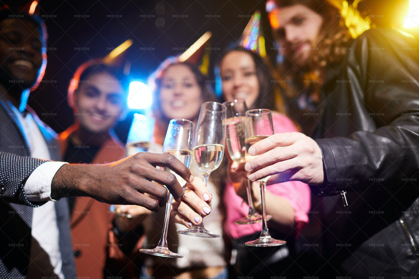 Full Champagne Flutes In Hands Of...: Stock Photos