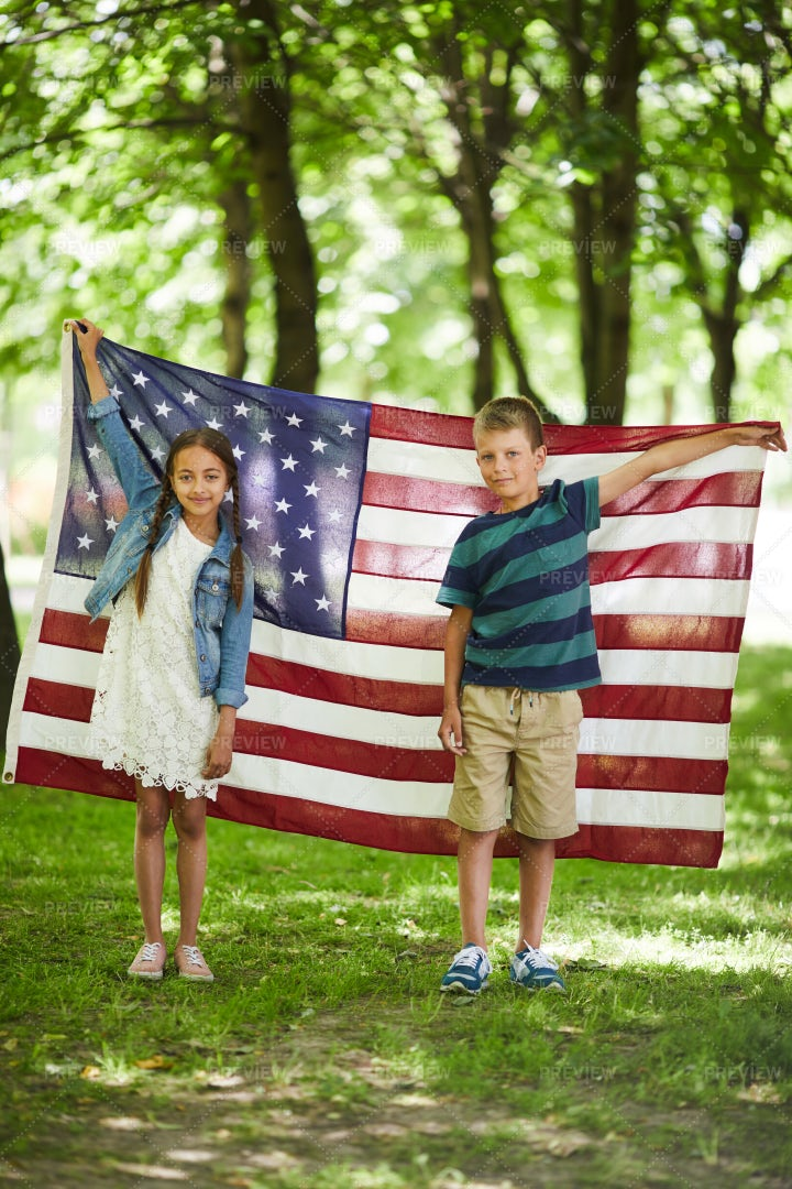 American Kids Holding National Flag: Stock Photos
