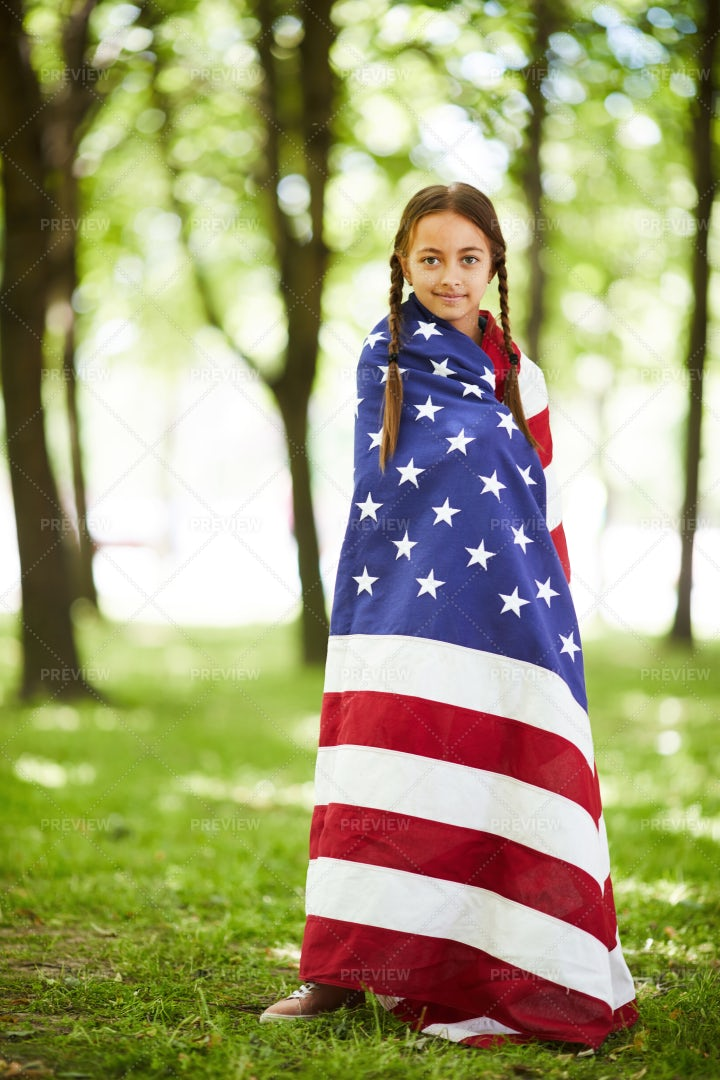 Pretty Girl Wrapped In American...: Stock Photos