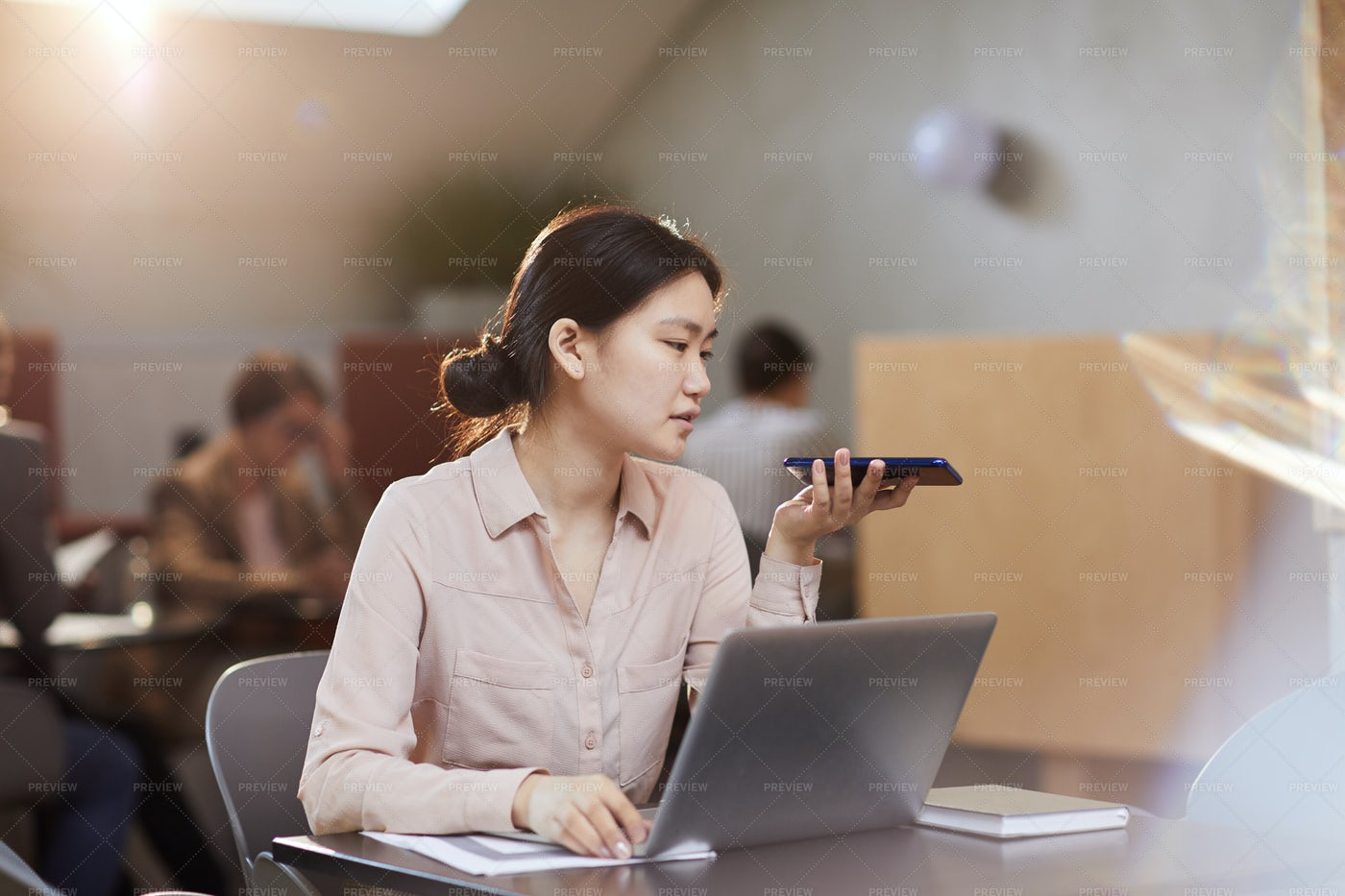 Asian Businesswoman Working In Cafe: Stock Photos