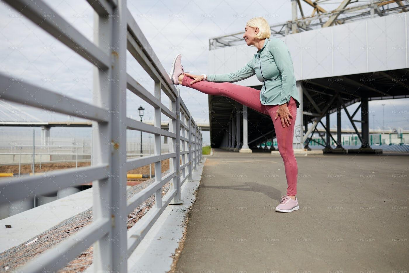 Stretching At Workout: Stock Photos