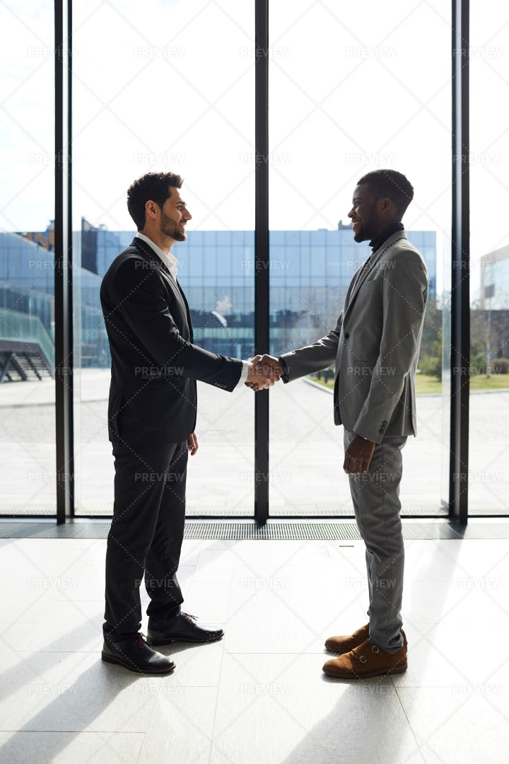 Welcoming Business Partner To...: Stock Photos