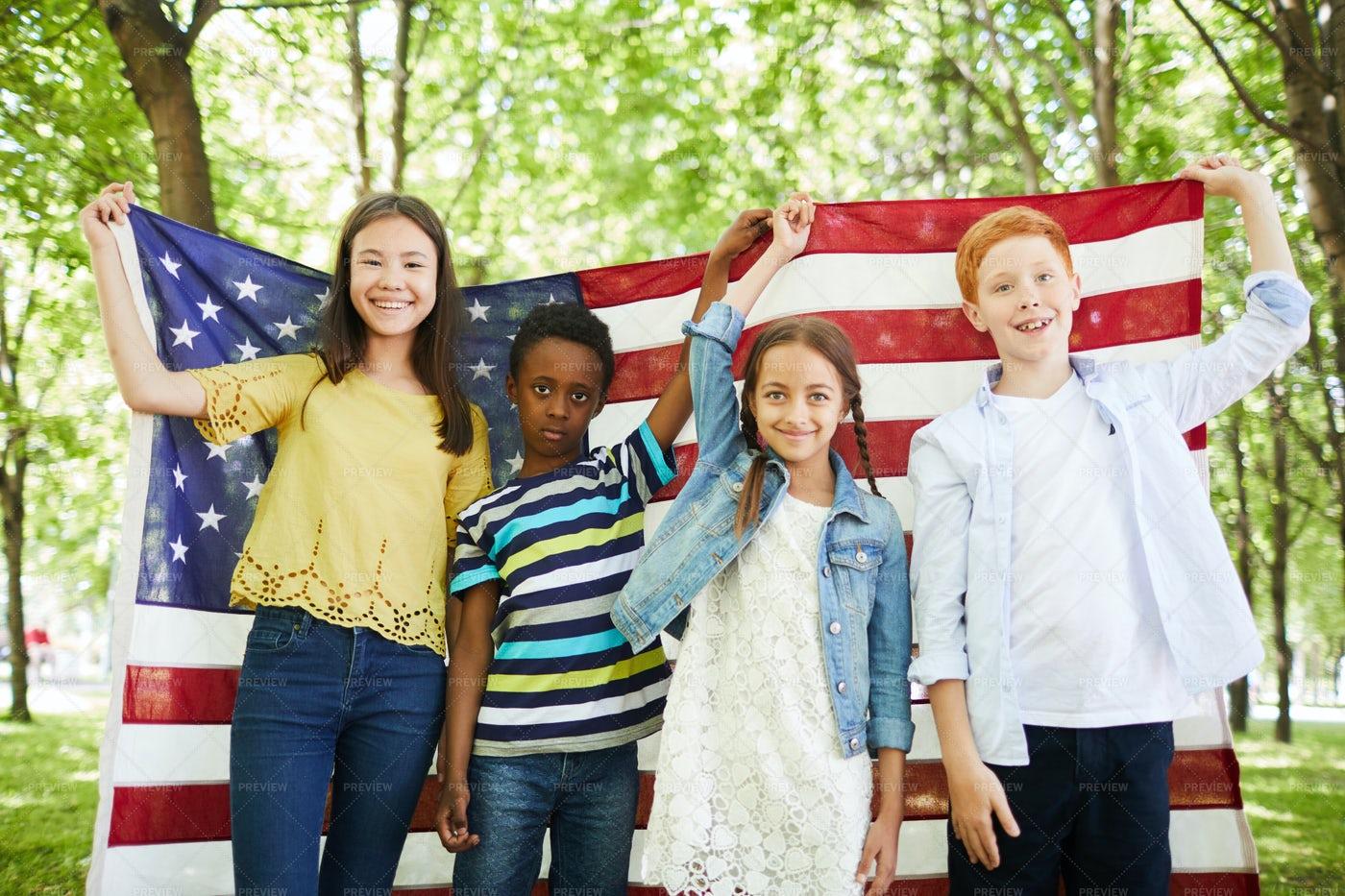 Positive Multi-ethnic Kids Holding...: Stock Photos