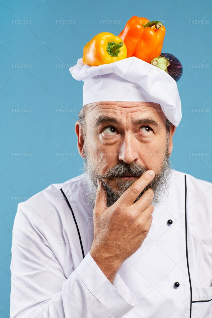 Bearded Chef Thinking On Blue: Stock Photos