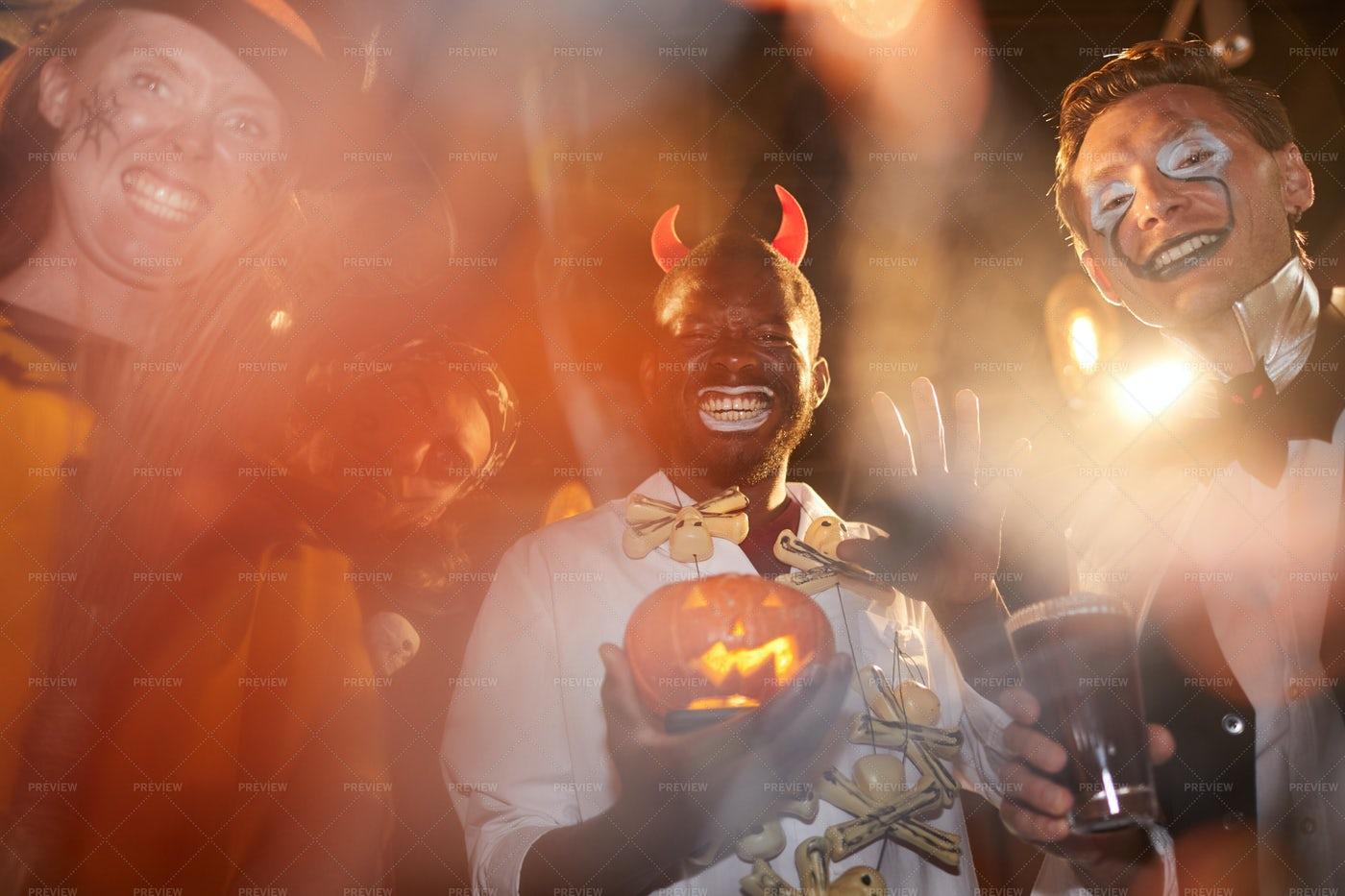 Men Wearing Halloween Costumes In...: Stock Photos