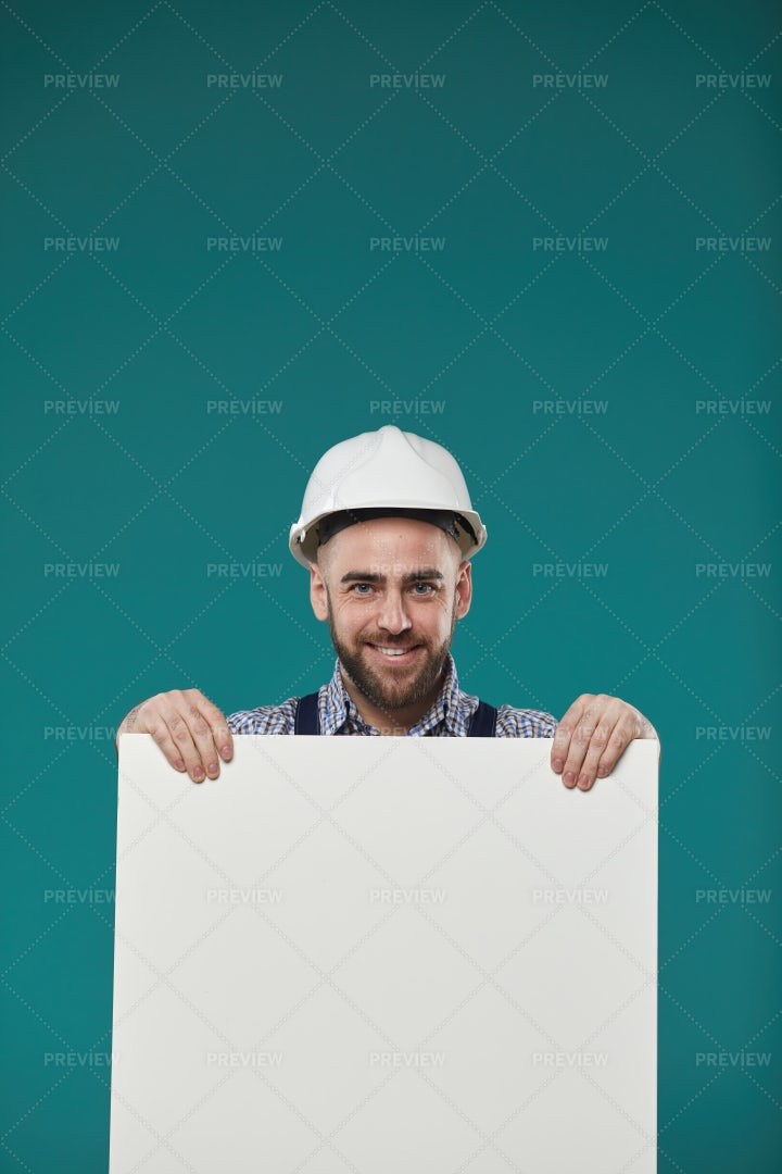 Manual Worker With Blank Poster: Stock Photos