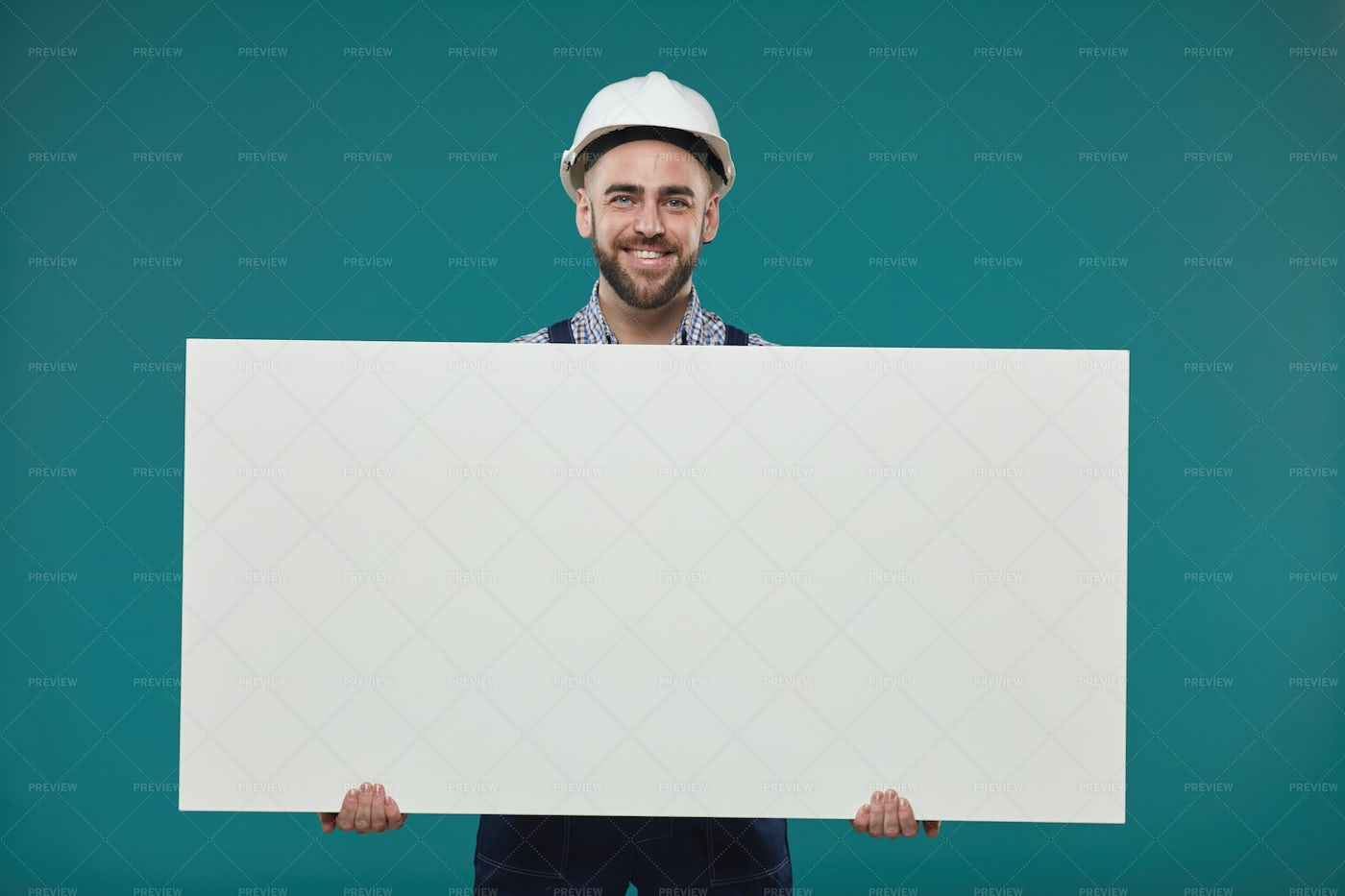 Cheerful Worker With Blank Poster: Stock Photos