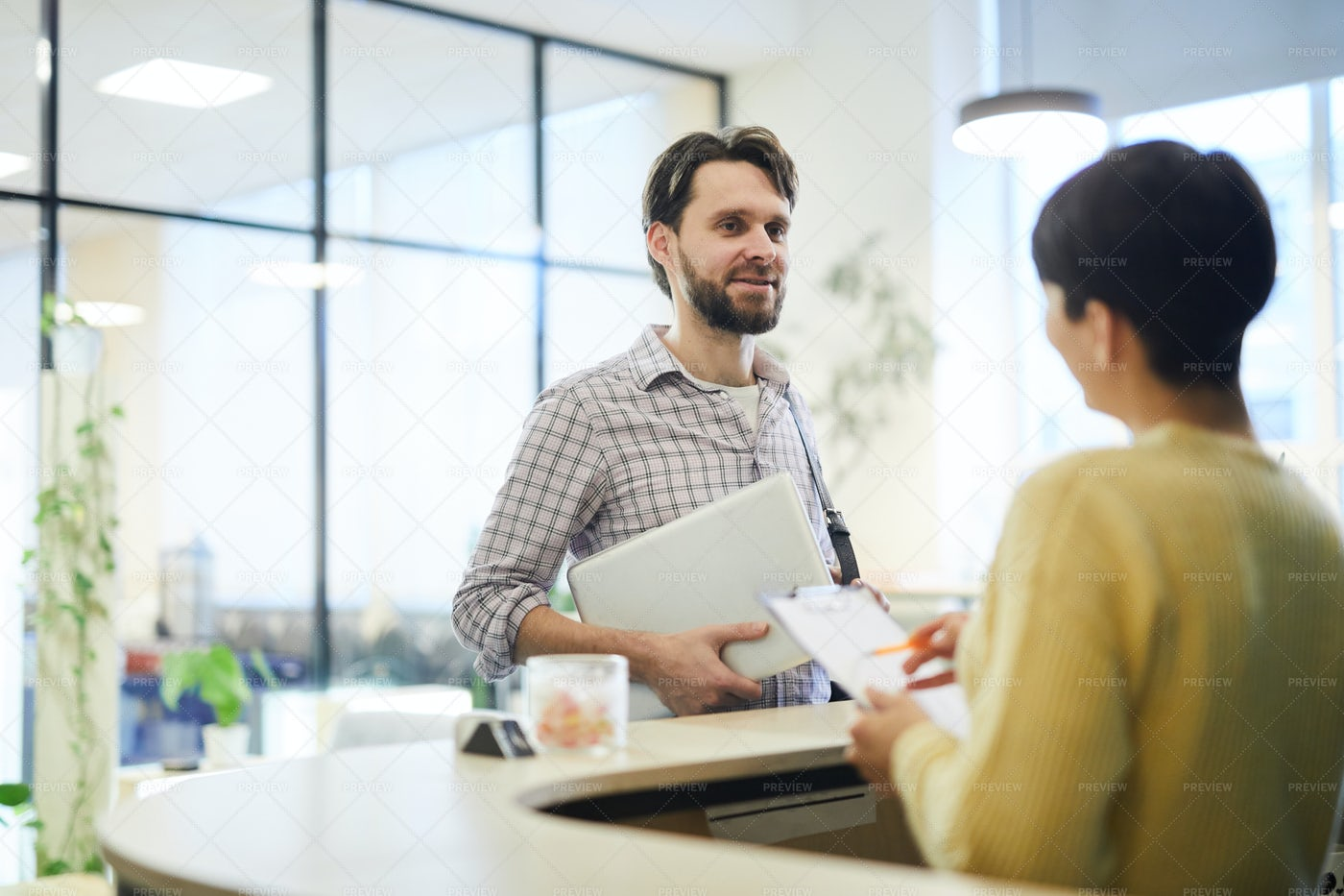 Young Programmer Talking To Hotel...: Stock Photos
