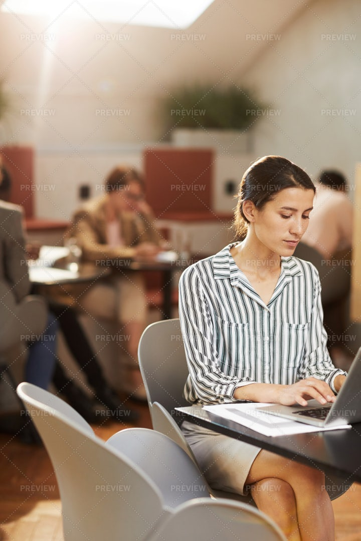 Woman Working In Cafe: Stock Photos