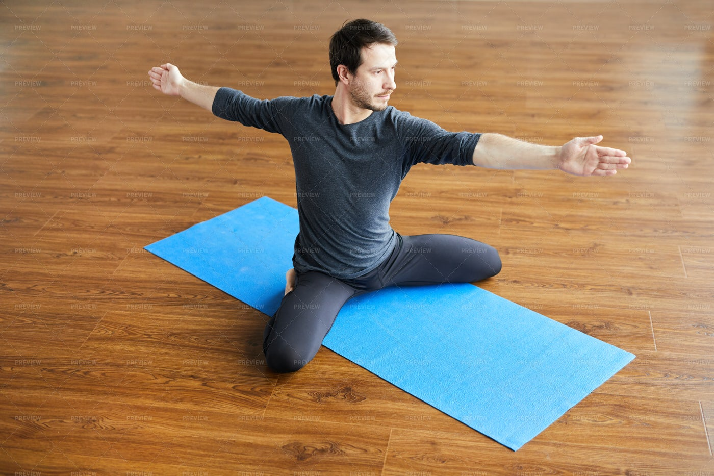Supple Man Practicing Yoga: Stock Photos
