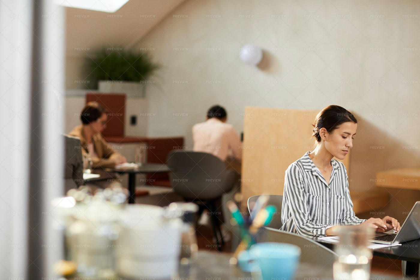 Woman Using Internet In Cafe: Stock Photos