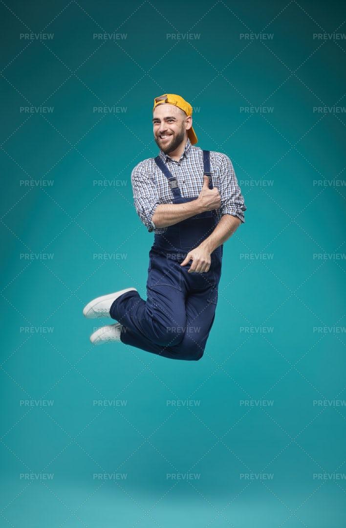 Joyful Worker Jumping Studio Shot: Stock Photos