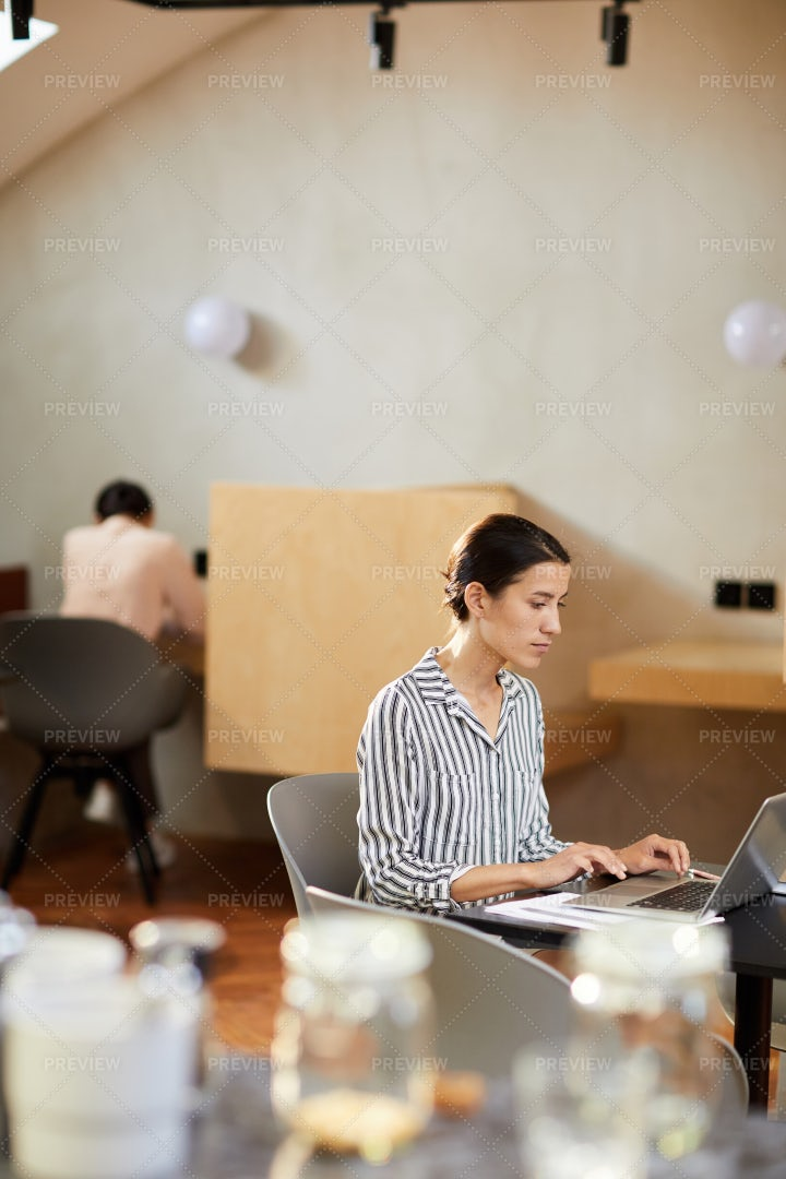 Young Woman Using Internet In Cafe: Stock Photos