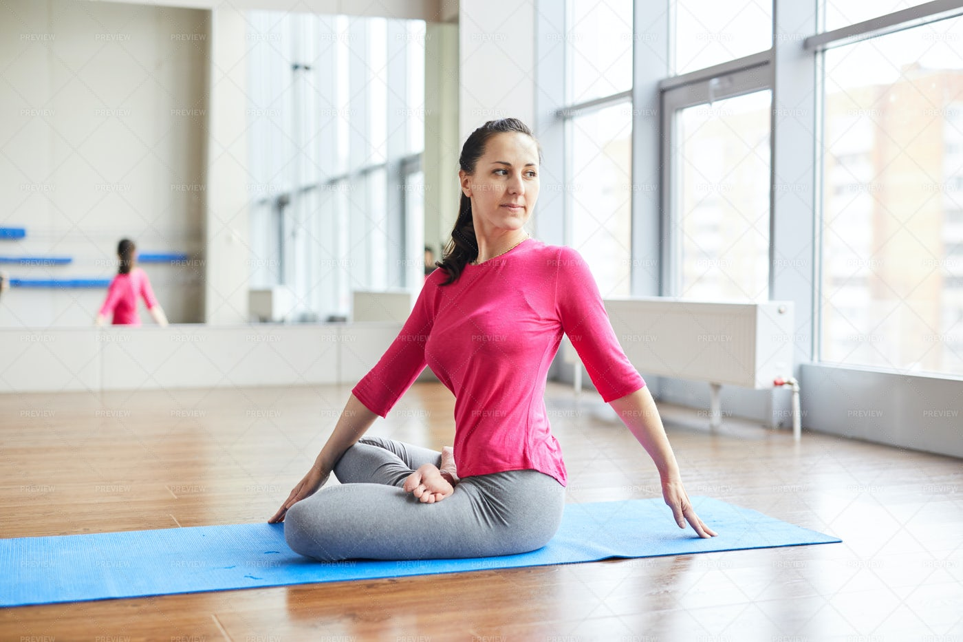 Twisting Body While Practicing Yoga: Stock Photos