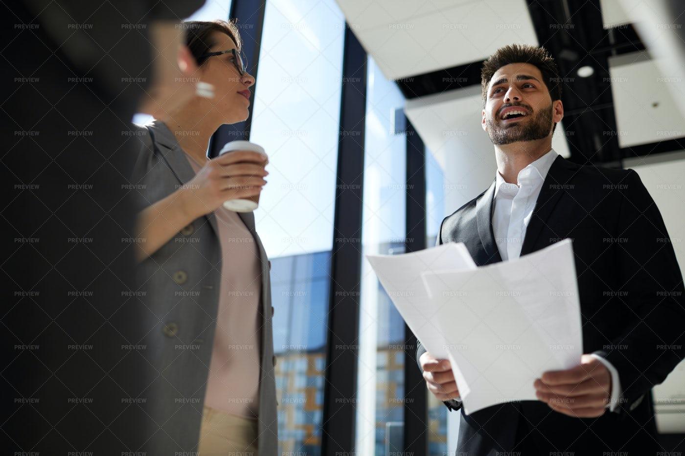 Cheerful Businessman Reading Report...: Stock Photos