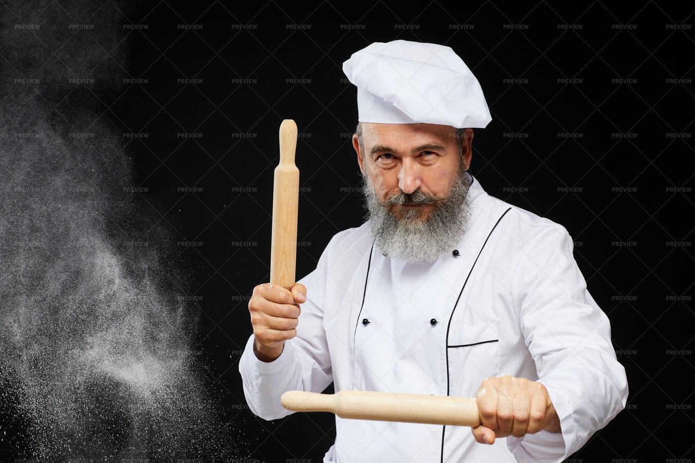Bearded Senior Baker Posing On...: Stock Photos