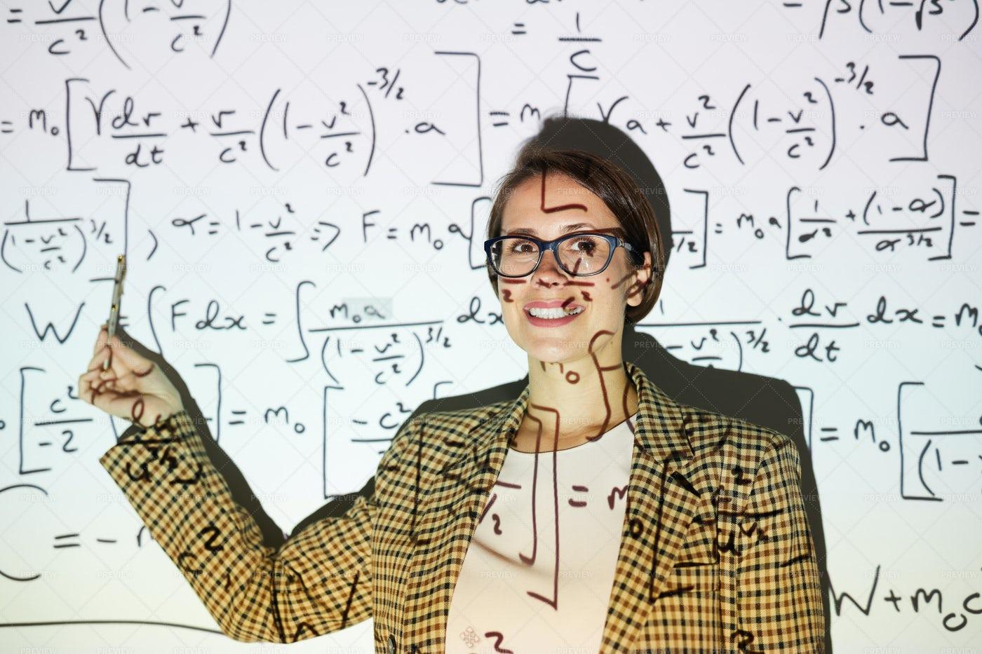Businesswoman Calculating Formulas: Stock Photos