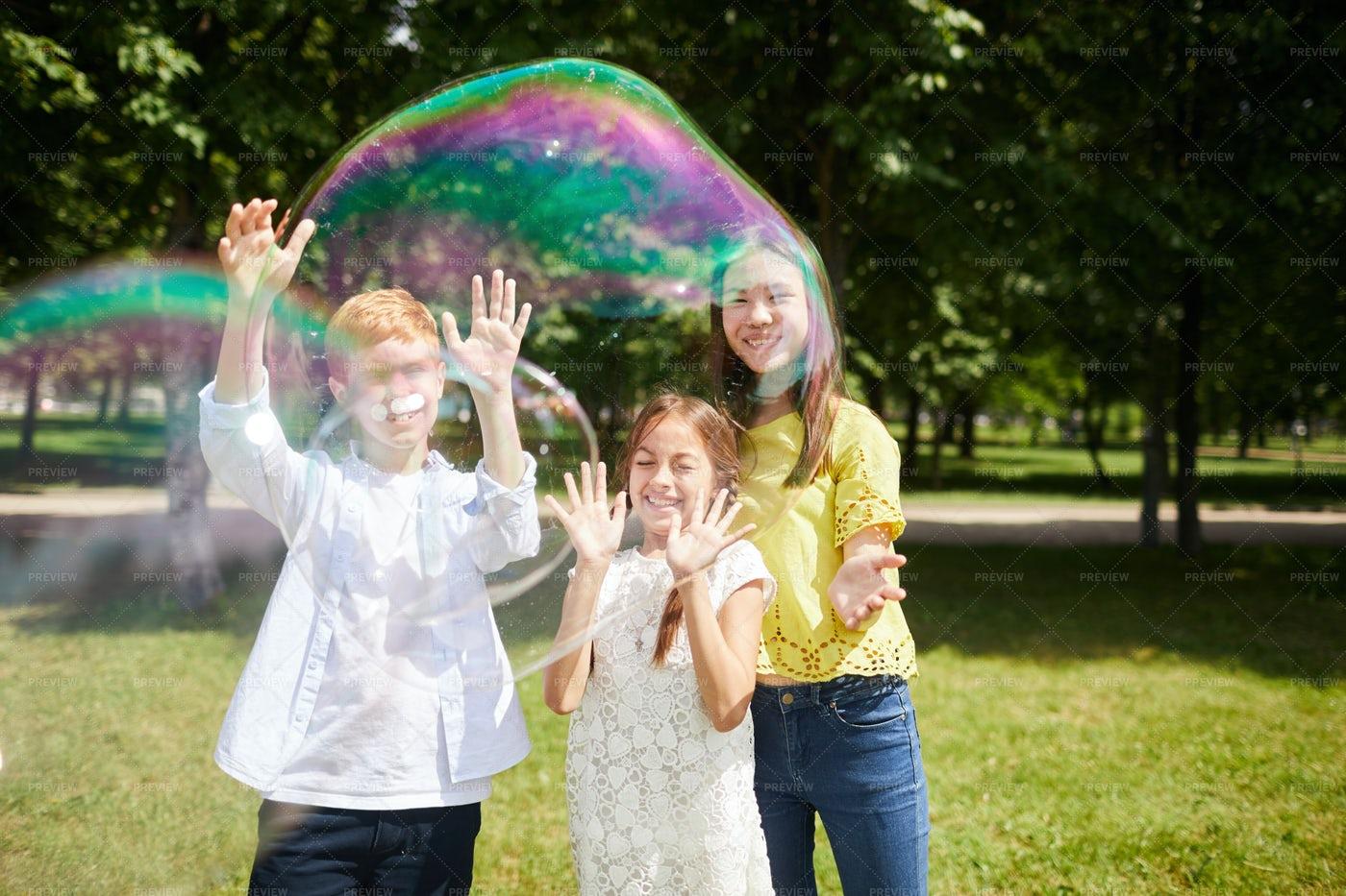 Jolly Multi-ethnic Kids Playing...: Stock Photos