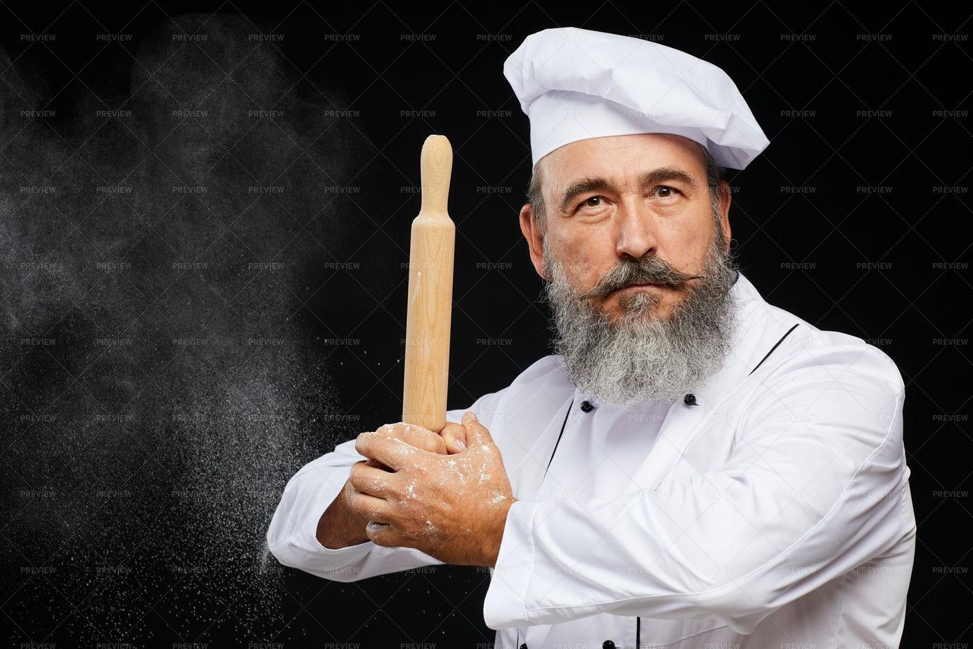 Senior Baker Posing Against Black...: Stock Photos