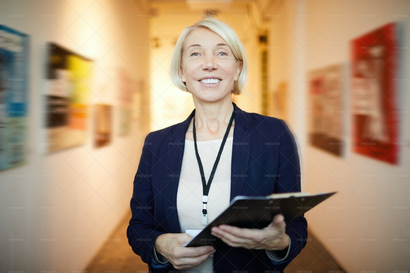 Smiling Art Gallery Manager: Stock Photos