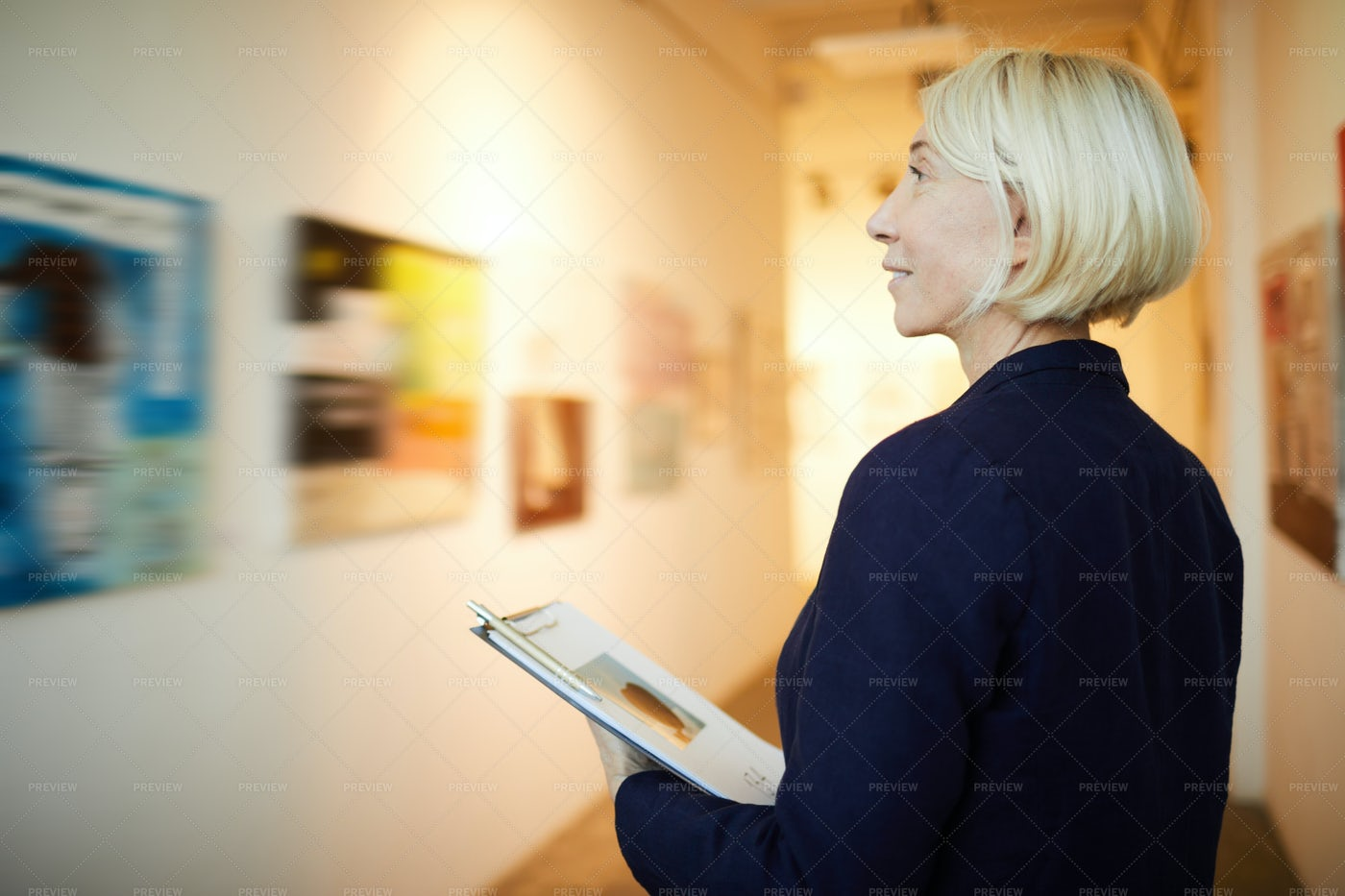 Gallery Manager In Museum: Stock Photos