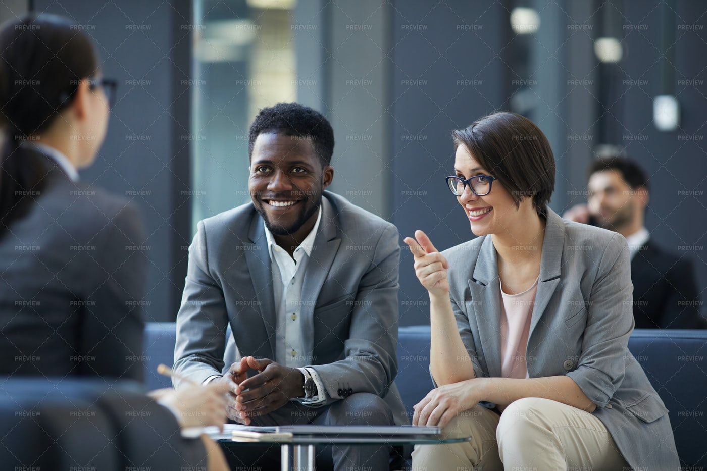 Sharing Ideas At Informal Meeting: Stock Photos