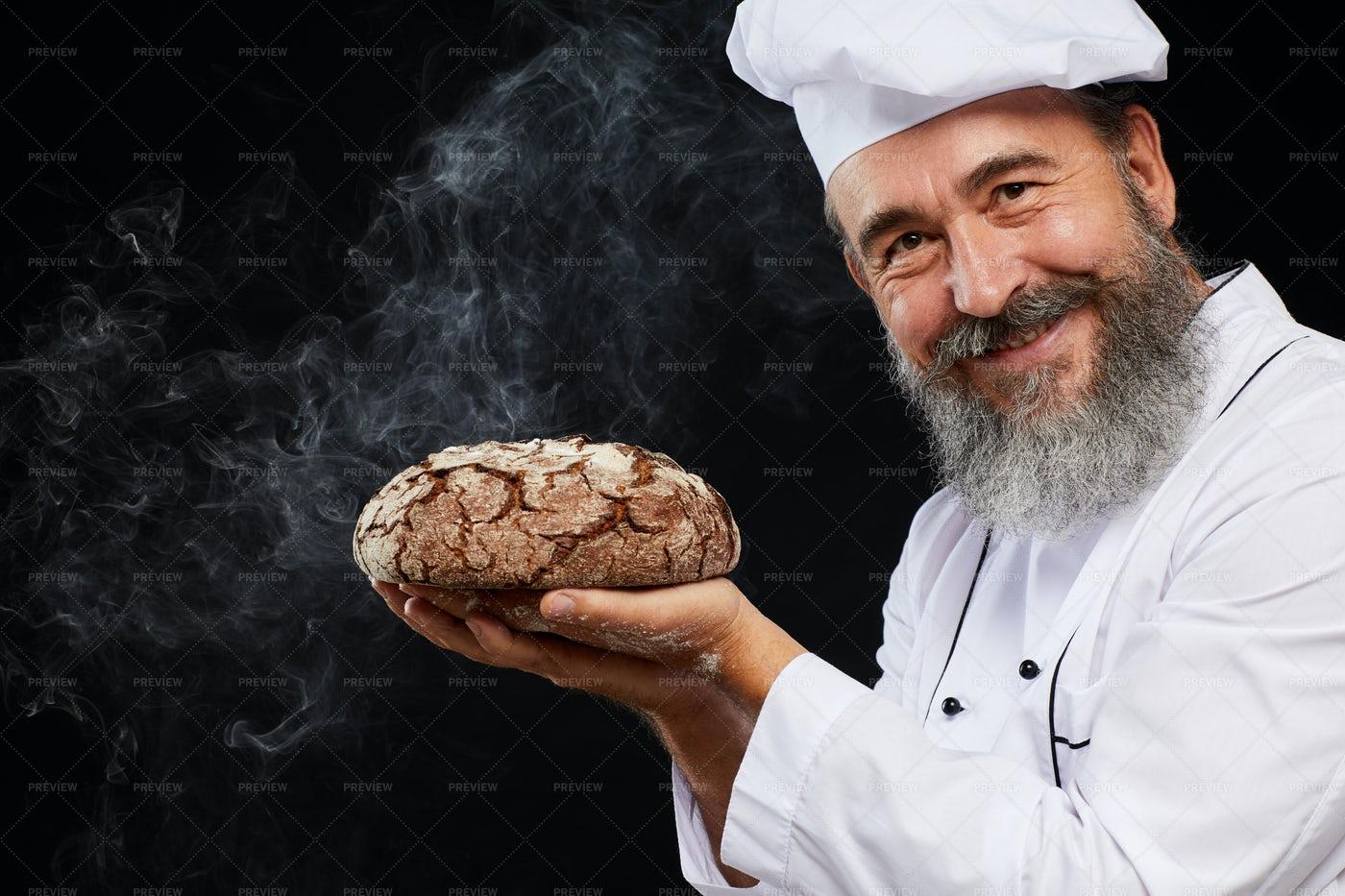 Smiling Baker Holding Fresh Bread...: Stock Photos