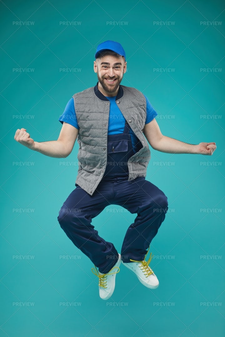 Happy Male Worker Jumping: Stock Photos