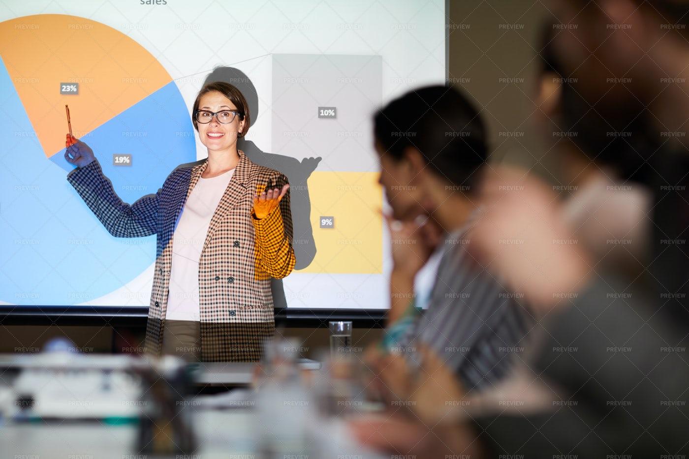 Businesswoman Presenting Report: Stock Photos