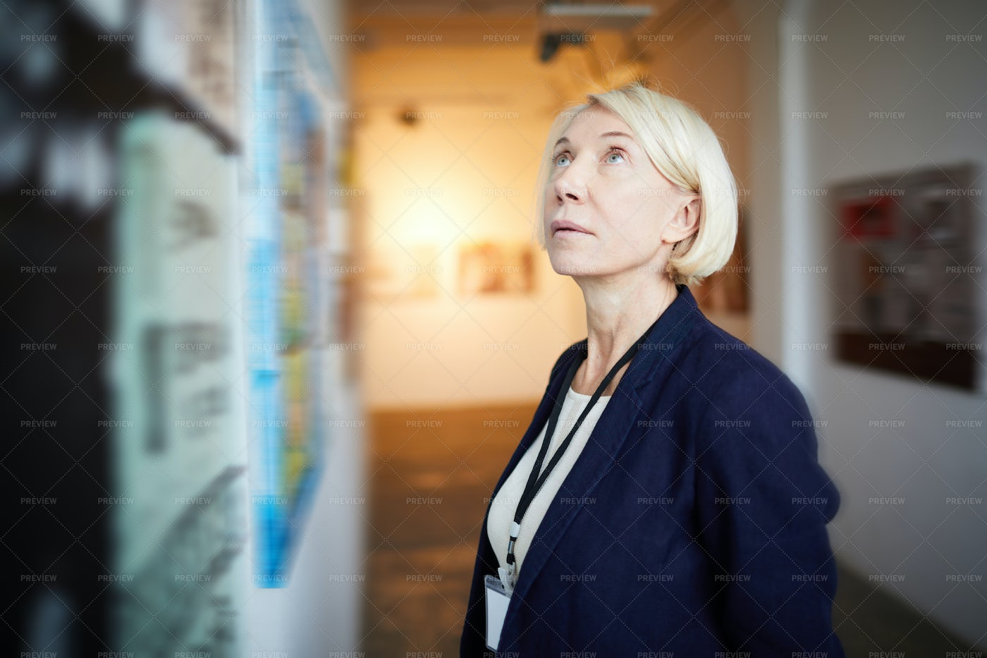 Mature Woman In Art Gallery: Stock Photos