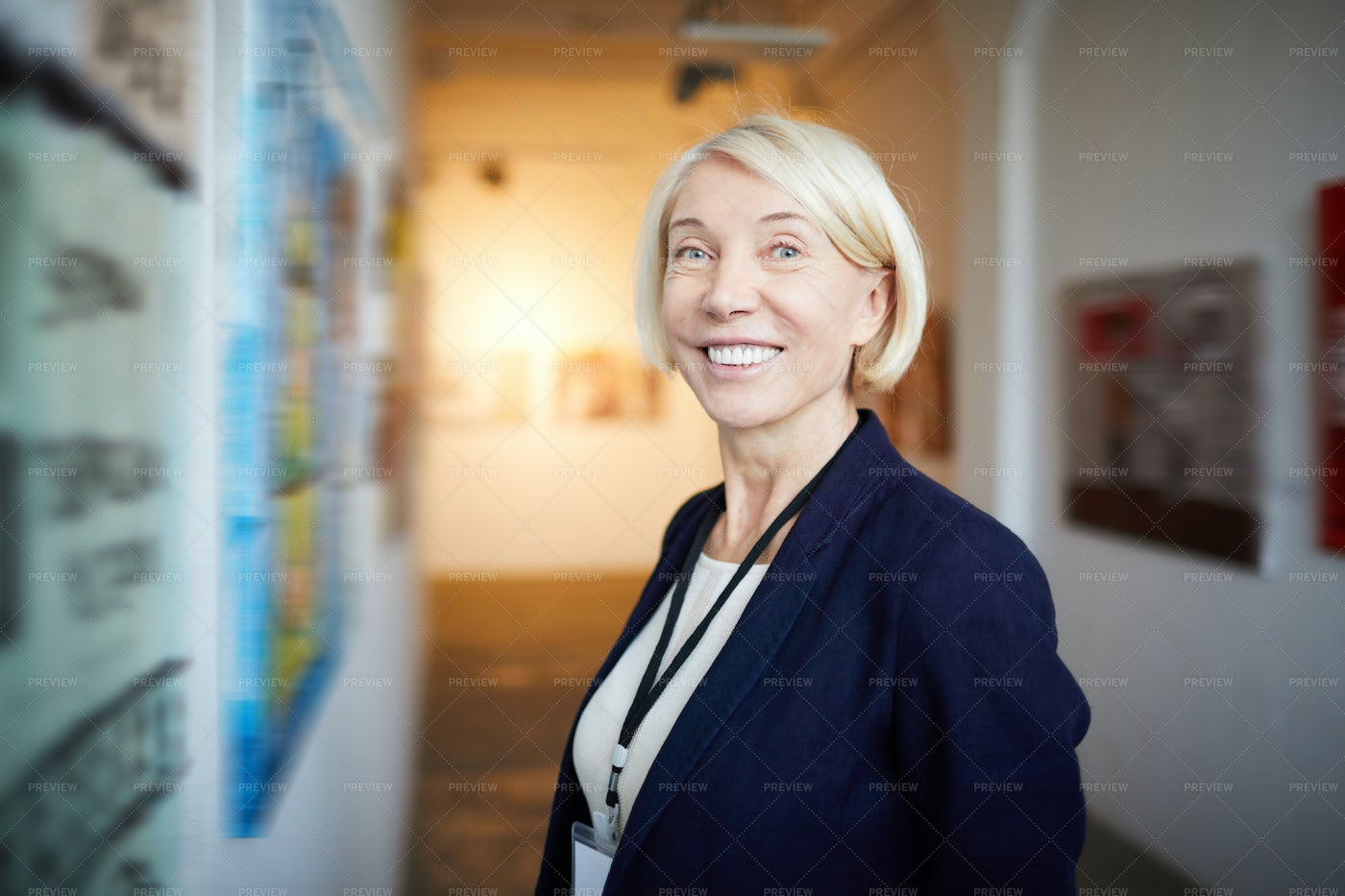 Smiling Woman In Art Gallery: Stock Photos