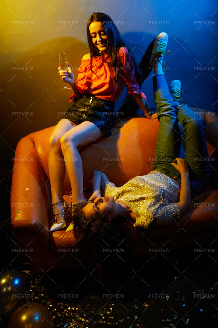 Stylish Girls Relaxing On Sofa In...: Stock Photos
