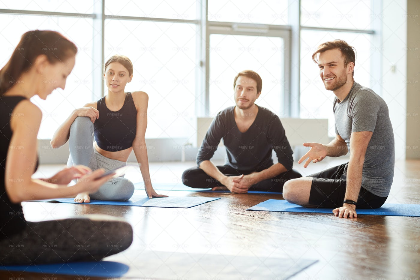 Talking To Yoga Teacher At Class: Stock Photos